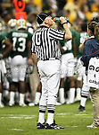 Umpire Jerry Meyerhoff takes a refreshing drink of Gatorade during the 2010 Texas  Bowl football game between the Illinois  Fighting Illini and the Baylor Bears at the Reliant Stadium in Houston, Tx. Illinois defeats Baylor 38 to 14....