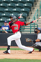 Lewis Brinson (25) of the Hickory Crawdads follows through on his swing against the Asheville Tourists at L.P. Frans Stadium on April 13, 2014 in Hickory, North Carolina.  The Tourists defeated the Crawdads 5-4.  (Brian Westerholt/Four Seam Images)