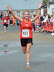 Maureen Harbison crosses the line as the first lady home in the Integral Clogherhead 10K. Photo:Colin Bell/pressphotos.ie