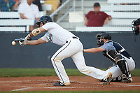 Spencer Bright (11) (Carson Newman) of the Mooresville Spinners lays down a bunt during the game against the Carolina Venom at Moor Park on June 22, 2020 in Mooresville, NC.  The Spinners defeated the Venom 7-2. (Brian Westerholt/Four Seam Images)