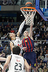 Real Madrid's Gustavo Ayon (l) and FC Barcelona's Mario Hezonja during Euroleague match.February 5,2015. (ALTERPHOTOS/Acero)