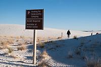Heidi Wickersham walks on the Playa Trail at White Sands National Monument near Alamogordo, New Mexico, USA, on Sat., Dec. 30, 2017.