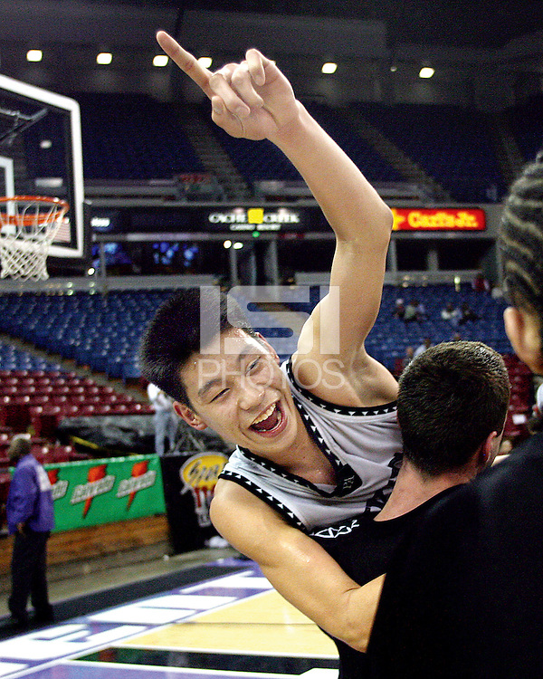 Palo Alto High School's Jeremy Lin and Cooper Miller ( back to camera)  celebrate their victory during Friday, March 17, 2006, California Interscholastic Federation state championship game. Palo Alto High School won the boys division II game 51-47.  ( @ Photo by Norbert von der Groeben/ )