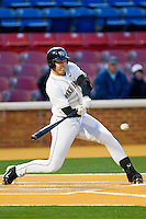 Matt Conway #25 of the Wake Forest Demon Deacons takes his swings against the North Carolina Tar Heels at Gene Hooks Field on March 11, 2011 in Winston-Salem, North Carolina.  Photo by Brian Westerholt / Four Seam Images