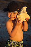 Little boy with a big shell, Central Coast, California