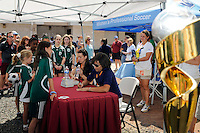 Sara Whalen and Saskia Webber sign autographs before the game. Sky Blue FC defeated the Boston Breakers 1-0 during a Women's Professional Soccer match at Yurcak Field in Piscataway, NJ, on July 4, 2009.