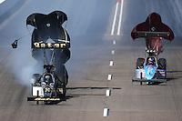 Feb. 23, 2013; Chandler, AZ, USA; NHRA top fuel dragster driver Khalid Albalooshi (left) alongside Mike Strasburg during qualifying for the Arizona Nationals at Firebird International Raceway. Mandatory Credit: Mark J. Rebilas-