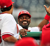 30 September 2009: Washington Nationals' first base coach Marquis Grissom smiles in the dugout prior to a game against the New York Mets at Nationals Park in Washington, DC. The Nationals rallied in the bottom of the 9th inning on a Justin Maxwell walk-off Grand Slam to win 7-4 and sweep the Mets 3-game series capping the Nationals' 2009 home season. Mandatory Credit: Ed Wolfstein Photo