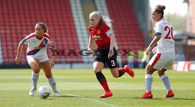 Alex Greenwood of Manchester United Women runs through Palace Ladies defence