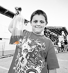 Boy with fish at the fair
