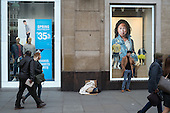Blanket and cardboard of a rough sleeper outside a Gap store in Oxford Street, Lonfon.