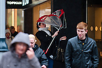 Wednesday 12 February 2014<br /> Pictured: The wind catches a young woman's umbrella as she shops along Swansea's Oxford Street<br /> Re: People struggle with the high winds in the center of Swansea. The met office has today issued more warnings of extreme weather over the next few days.