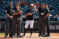 Home plate umpire Ryan Morehead (right) goes over the grounds rules with Vanderbilt Commodores head coach Tim Corbin (4) and Sam Houston State Bearkats head coach Matt Deggs as umpires Matt McKendry, Chris Booker, and Michael Start look on prior to game one of the 2018 Shriners Hospitals for Children College Classic at Minute Maid Park on March 2, 2018 in Houston, Texas. The Bearkats walked-off the Commodores 7-6 in 10 innings.   (Brian Westerholt/Four Seam Images)