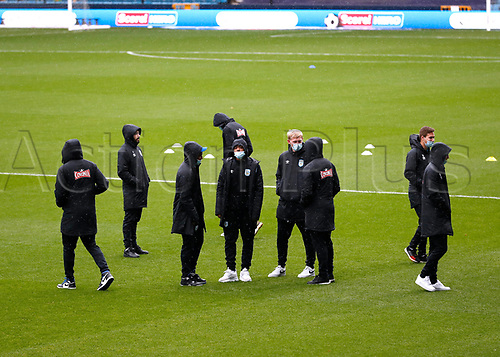 31st October 2020; The Den, Bermondsey, London, England; English Championship Football, Millwall Football Club versus Huddersfield Town; Huddersfield Town players inspect the pitch which wearing face masks