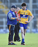 Clare manager Maurice Walsh has a word with player Mark Mc Inerney during their Munster Minor football semi-final against Tipperary at Thurles. Photograph by John Kelly.