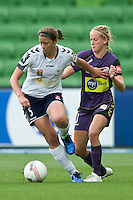 MELBOURNE, AUSTRALIA - DECEMBER 18: Louisa BISBY of the Victory protects the ball during the round 7 W-League match between the Melbourne Victory and the Perth Glory at AAMI Park on December 18, 2010 in Melbourne, Australia. (Photo Sydney Low / asteriskimages.com)