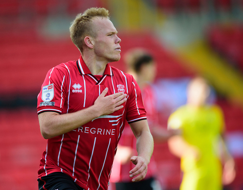 Lincoln City's Anthony Scully celebrates scoring the opening goal<br /> <br /> Photographer Andrew Vaughan/CameraSport<br /> <br /> The EFL Sky Bet League One - Saturday 12th September  2020 - Lincoln City v Oxford United - LNER Stadium - Lincoln<br /> <br /> World Copyright © 2020 CameraSport. All rights reserved. 43 Linden Ave. Countesthorpe. Leicester. England. LE8 5PG - Tel: +44 (0) 116 277 4147 - admin@camerasport.com - www.camerasport.com - Lincoln City v Oxford United