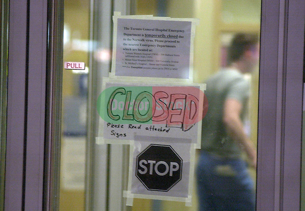 hand-written CLOSED sign on glass door at emergency room entrance to large city hospital  during an urban health emergency