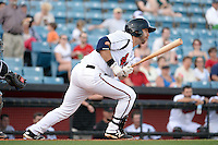 Nashville Sounds third baseman Taylor Green (3) at bat during the first game of a double header against the Omaha Storm Chasers on May 21, 2014 at Herschel Greer Stadium in Nashville, Tennessee.  Nashville defeated Omaha 5-4.  (Mike Janes/Four Seam Images)