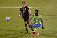 COLUMBUS, OH - DECEMBER 12: Yeimar Gomez Andrade #28 of Seattle Sounders FC battle for the ball against Aidan Morris #21 of Columbus Crew during a game between Seattle Sounders FC and Columbus Crew at MAPFRE Stadium on December 12, 2020 in Columbus, Ohio.