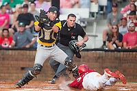 Bristol Pirates catcher John Bormann (35) prepares to apply a tag to Magneuris Sierra (37) of the Johnson City Cardinals as he tries to score in the bottom of the first inning at Howard Johnson Field at Cardinal Park on July 6, 2015 in Johnson City, Tennessee.  The Cardinals defeated the Pirates 8-2 in game two of a double-header. (Brian Westerholt/Four Seam Images)