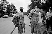 Columbus, Georgia<br /> March 12, 2007<br /> <br /> Becky Johnson gives her son Private Adam Behrend a heartfelt farewell hug before he is deployed to Iraq. 450 soldiers of the third infantry, third brigade are deployed to Iraq from Fort Benning, Georgia, many for their second or third tour of duty.<br /> <br /> Soldiers spent their last minutes with their families on the base before separating and boarding a bus to the base airport.<br /> <br /> Becky Johnson gives a lasting and heartfelt farewell hug to her son Private Adam Behrend before he is deployed to Iraq. His father Peter Behrend is to the right of the frame as they drove down from Wisconsin to see his off.