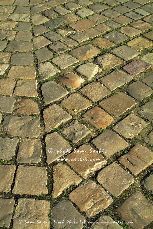 Cobblestones in the courtyard of the Louvre Museum, Paris, France.