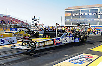 Feb. 17 2012; Chandler, AZ, USA; NHRA top fuel dragster driver Antron Brown (near lane) races alongside Spencer Massey during qualifying for the Arizona Nationals at Firebird International Raceway. Mandatory Credit: Mark J. Rebilas-