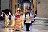 Members of the Philippine community arrive to take part in a Pope's mass to mark 500 years of Christianity in the Philippines, Sunday, March 14, 2021. at St. Peter's Basilica in The Vatican.