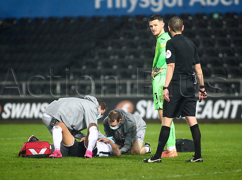 21st November 2020; Liberty Stadium, Swansea, Glamorgan, Wales; English Football League Championship Football, Swansea City versus Rotherham United; Kyle Naughton of Swansea City receives treatment during the second half