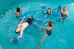 Auroville, India - April 2021: Human Unity in Covid Time. Watsu therapy, dancing in the water at Quiet Healing Centre.