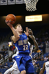 Air Force's Max Yon shoots past Nevada defender Jerry Evans, Jr. during an NCAA basketball game in Reno, Nev., on Saturday, Feb. 1, 2014. Nevada won 69-56 in overtime. (AP Photo/Cathleen Allison)