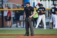 Home plate umpire Garrett Griffin works the Appalachian League game between the Bluefield Ridge Runners and the Burlington Sock Puppets at Burlington Athletic Park on June 8, 2021 in Burlington, North Carolina. (Brian Westerholt/Four Seam Images)