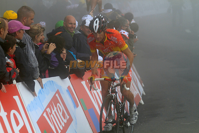 Spanish Champion José Ivan Gutierrez Palacios (ESP) Caisse d'Epargne approaches the summit finish of the Col du Tourmalet during a wet foggy Stage 17 of the 2010 Tour de France running 174km from Pau to Col du Tourmalet, France. 22nd July 2010.<br /> (Photo by Eoin Clarke/NEWSFILE).<br /> All photos usage must carry mandatory copyright credit (© NEWSFILE | Eoin Clarke)