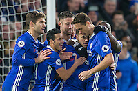 Pedro and teammates celebrate Eden Hazard of Chelsea goal from the penalty spot (his 50th Premier League goal) during the English Premier League match between Chelsea and Bournemouth at Stamford Bridge, London, England on 26 December 2016. Photo by Andy Rowland.