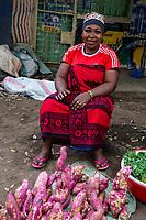 Tanzania.  Mto wa Mbu. Woman Selling Sweet Potatoes in the Market.