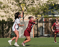 NEWTON, MA - MAY 14: Fiona McGowan #25 of University of Massachusetts and Bridget Whitaker #27 of Temple University face off during NCAA Division I Women's Lacrosse Tournament first round game between University of Massachusetts and Temple University at Newton Campus Lacrosse Field on May 14, 2021 in Newton, Massachusetts.