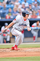 Lakewood BlueClaws designated hitter Henri Lartigue (11) swings at a pitch during a game against the Beer City Tourists at McCormick Field on June 1, 2017 in Asheville, North Carolina. The Tourists defeated the BlueClaws 8-5. (Tony Farlow/Four Seam Images)