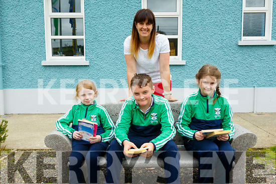 """Books Make Things Better: Lyrecrompane NS principal M/s Eilish Lyons pictuted with pupils Katie Brosnan, Timmy Cahill & Cara Mattinoe with books they received  under the Arts Council campaign """"Books Make  Things Better""""."""
