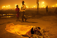India. Uttar Pradesh state. Allahabad. Maha Kumbh Mela. A dead man lies on his back on the ground. The Kumbh Mela, believed to be the largest religious gathering is held every 12 years on the banks of the 'Sangam'- the confluence of the holy rivers Ganga, Yamuna and the mythical Saraswati. The Maha (great) Kumbh Mela, which comes after 12 Purna Kumbh Mela, or 144 years, is always held at Allahabad. Uttar Pradesh (abbreviated U.P.) is a state located in northern India. 11.02.13 © 2013 Didier Ruef