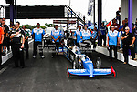The Peak Performance Racing team gets ready to race before the O'Reilly Auto Parts Spring Nationals Finals at the Royal Purple Raceway in Baytown,Texas.