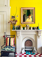The white-painted Victorian mantelpiece in the kitchen/dining area displays a collection of ceramics
