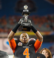 STANFORD, CA - January 2, 2012: Oklahoma State cornerback Justin Gilbert (4) awarded the Defensive Player of the Game at the Fiesta Bowl at University of Phoenix Stadium in Phoenix, AZ. Final score Oklahoma State wins 41-38.
