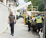 Pic shows: Jose Mourinho drives home in West London<br /> today<br /> 24.5.16<br /> He joked with builders on his way in<br /> <br /> Pic by Gavin Rodgers/Pixel 8000 Ltd