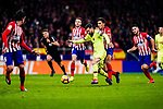 Lionel Messi of FC Barcelona (C) is challenged by Rodrigo Cascante of Atletico de Madrid (R) during the La Liga 2018-19 match between Atletico Madrid and FC Barcelona at Wanda Metropolitano on November 24 2018 in Madrid, Spain. Photo by Diego Souto / Power Sport Images