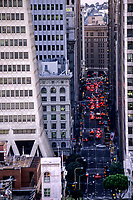 San Francisco, California.   Montgomery Street Traffic at Rush Hour.  Transamerica Building on left.  Support Structure shows how the base of the building incorporates design features to render the building less susceptible to earthquake damage.