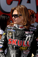 Apr 9, 2006; Las Vegas, NV, USA; NHRA Top Fuel driver Melanie Troxel, driver of the Skull Gear/Torco Race Fuels dragster prior to the start of eliminations at the SummitRacing.com Nationals at Las Vegas Motor Speedway in Las Vegas, NV. Mandatory Credit: Mark J. Rebilas