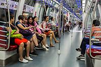Singapore.  Passengers inside an  MRT Mass Rapid Transit Train Car.
