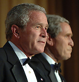 United States President  George W. Bush (L) and his inner self monologue, played by Steve Bridges, entertain guests at the White House Correspondents' Association Dinner in Washington on April 29, 2006. .Credit: Roger L. Wollenberg - Pool via CNP.
