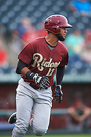 Frisco RoughRiders outfielder Nomar Mazara (12) runs to first during a game against the Springfield Cardinals on June 3, 2015 at Hammons Field in Springfield, Missouri.  Springfield defeated Frisco 7-2.  (Mike Janes/Four Seam Images)